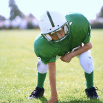 Ready Football Youth --- Image by © Royalty-Free/Corbis